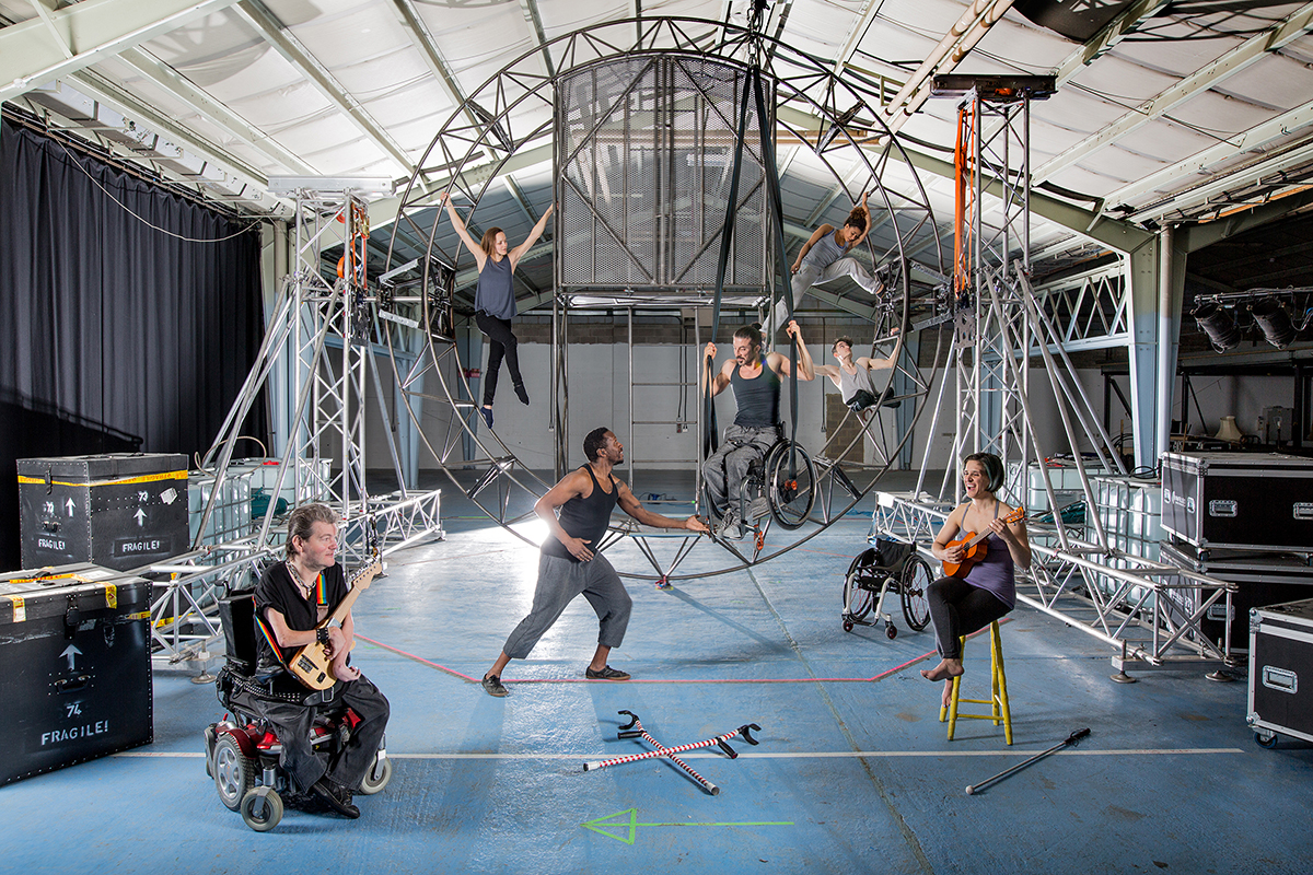 Seven extraordinary cast members, sit upon and around the new circular metal set for new show 'What Am I Worth?'