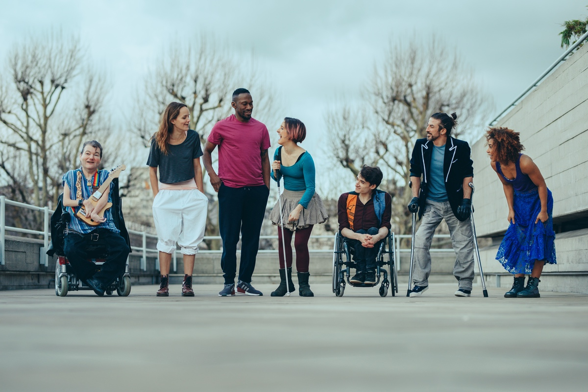 The cast for 'What am I Worth' stand in a line: John, Aislinn, David, Amelia, Johnny, Dergin and Alfa. They are all looking at each other and laughing.