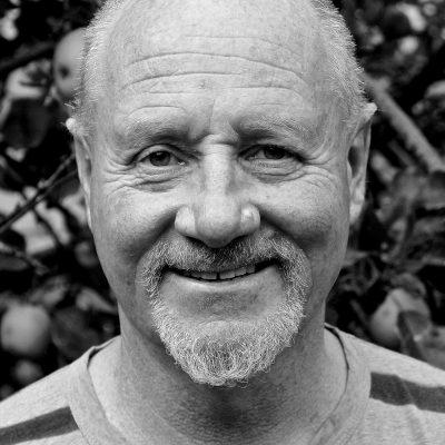 Headshot of Richard Headon, a white man with very short white hair and a goatee beard.