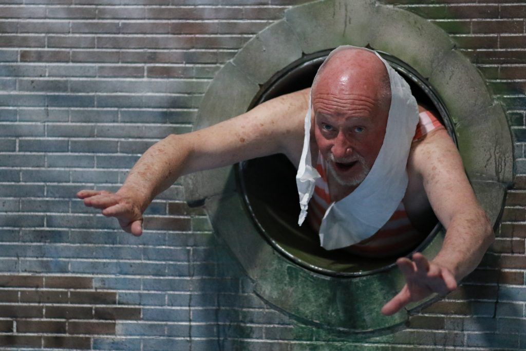 Richard Headon as Grandad dives in to the water through a pipe.